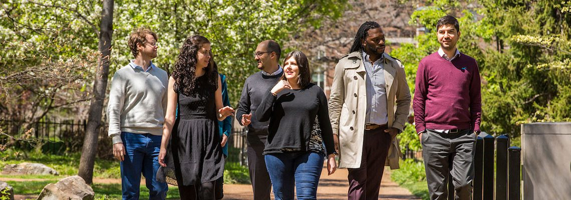 Multicultural group of students walking on campus